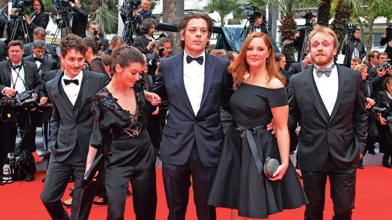 """Director and singer Benjamin Bioley (C) pose on the red carpet with the Talents Adami Cannes as they arrive for the screening of the film """"Foxcatcher"""" in competition at the 67th Cannes Film Festival in Cannes"""